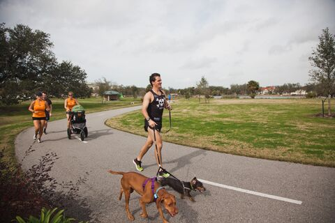 Visitors enjoy a walk along the Big Lake Trail in City Park, New Orleans