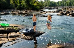 Leaping into the Chattahoochee River
