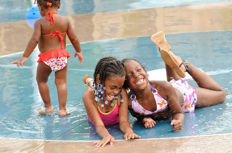 Three girls at a splash pad